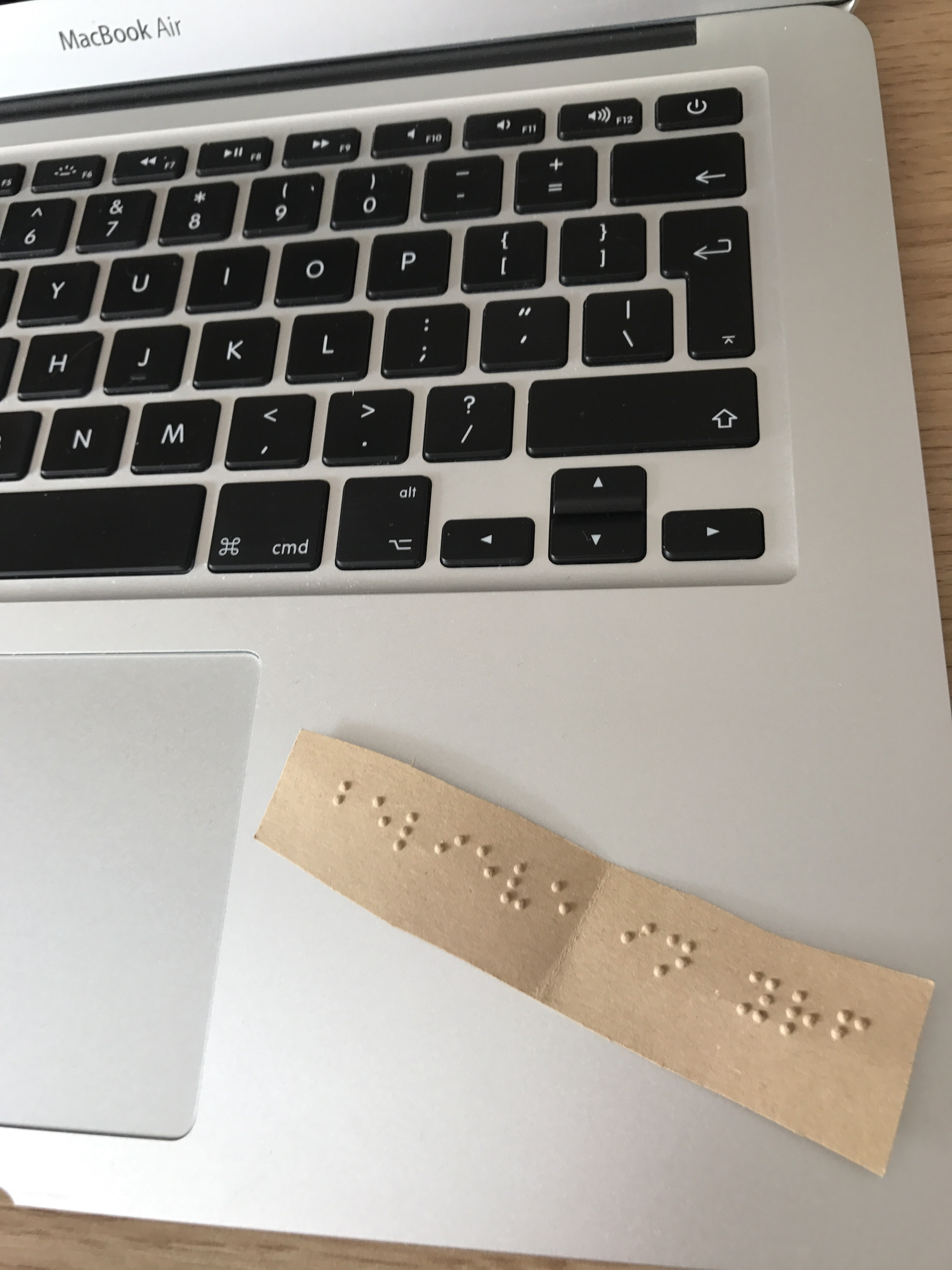 """A quote in braille that says """"believe in yourself"""""""