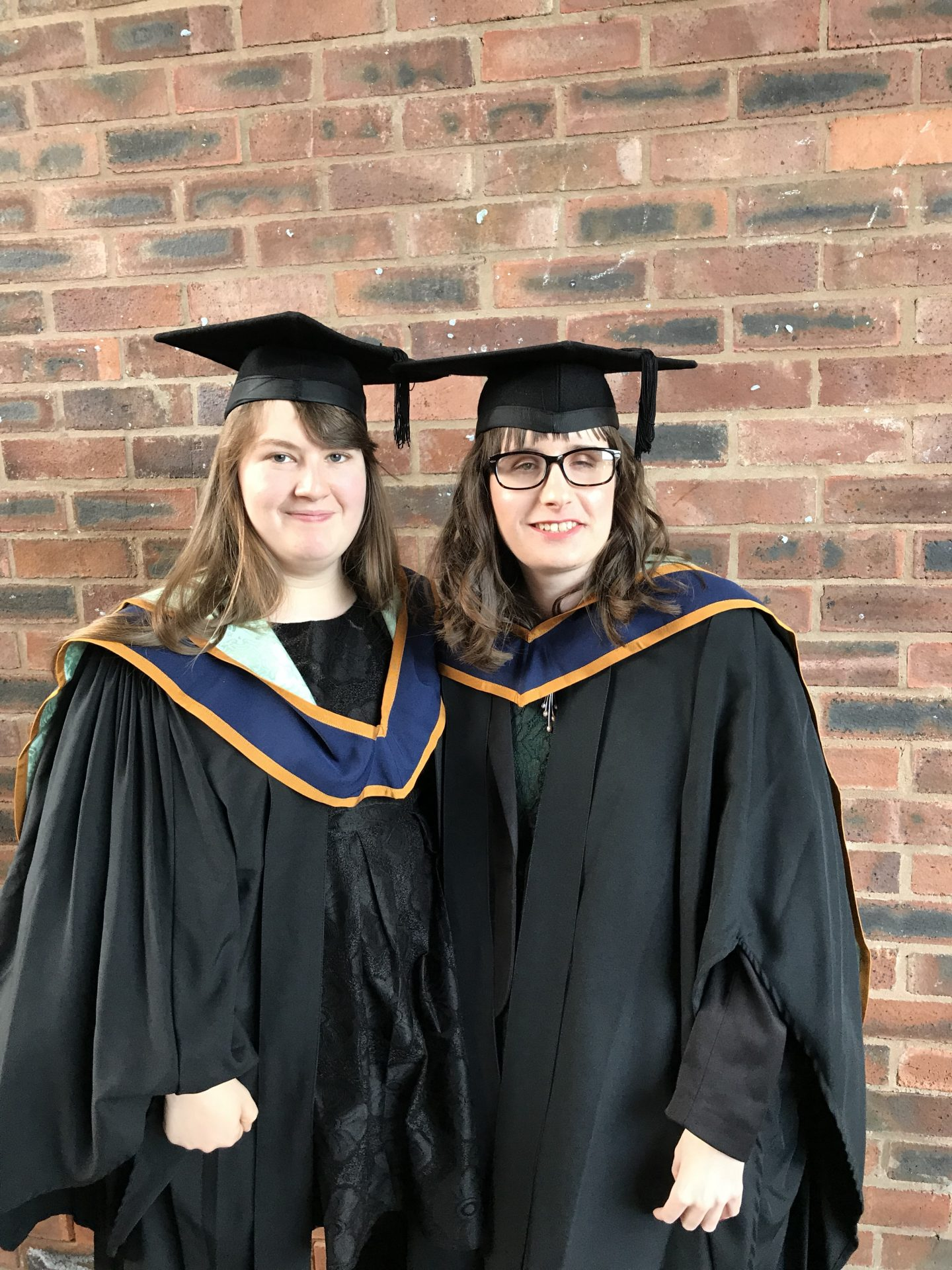 Holly and her friend in graduation out fits at York St John University