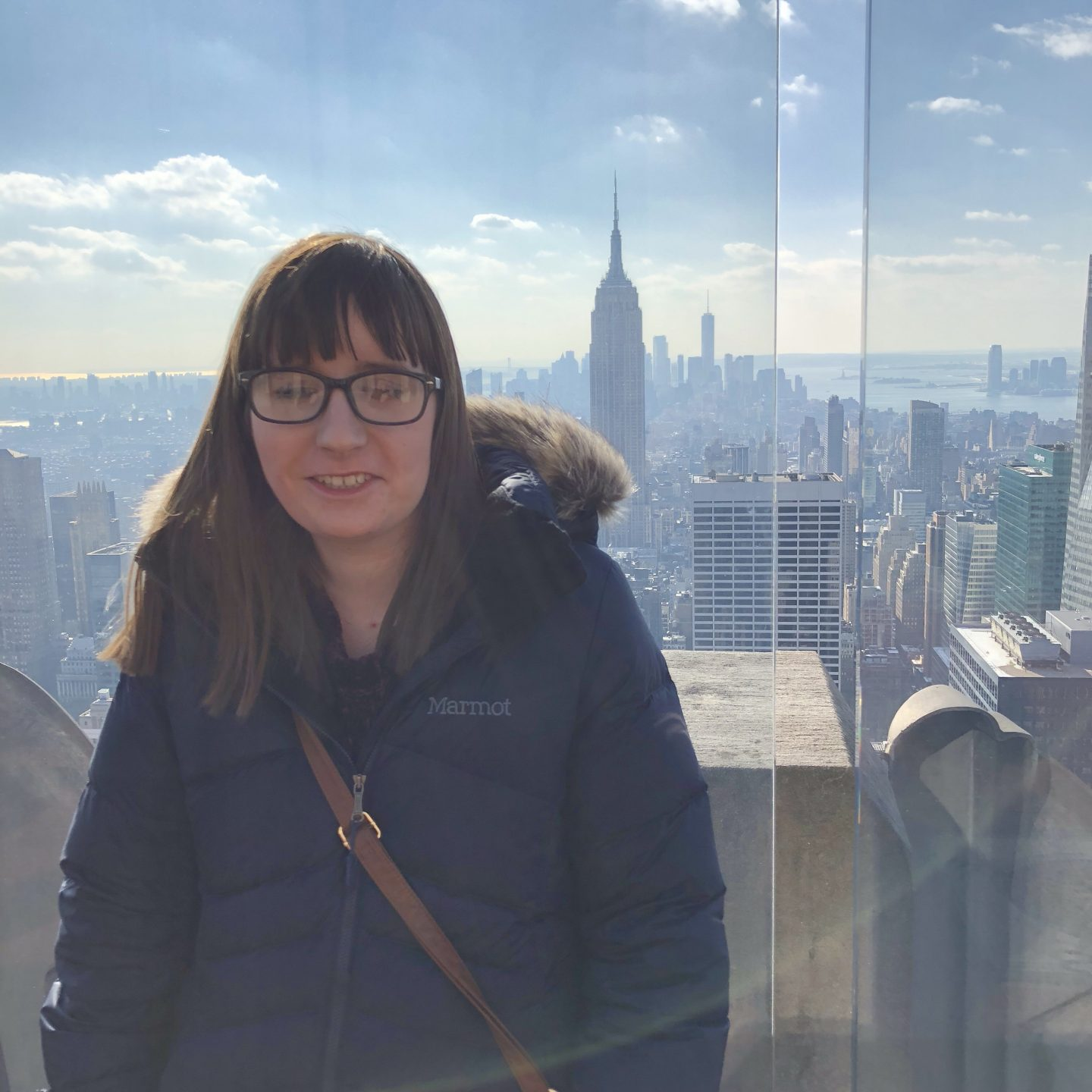A photo of Holly at the top of the rock