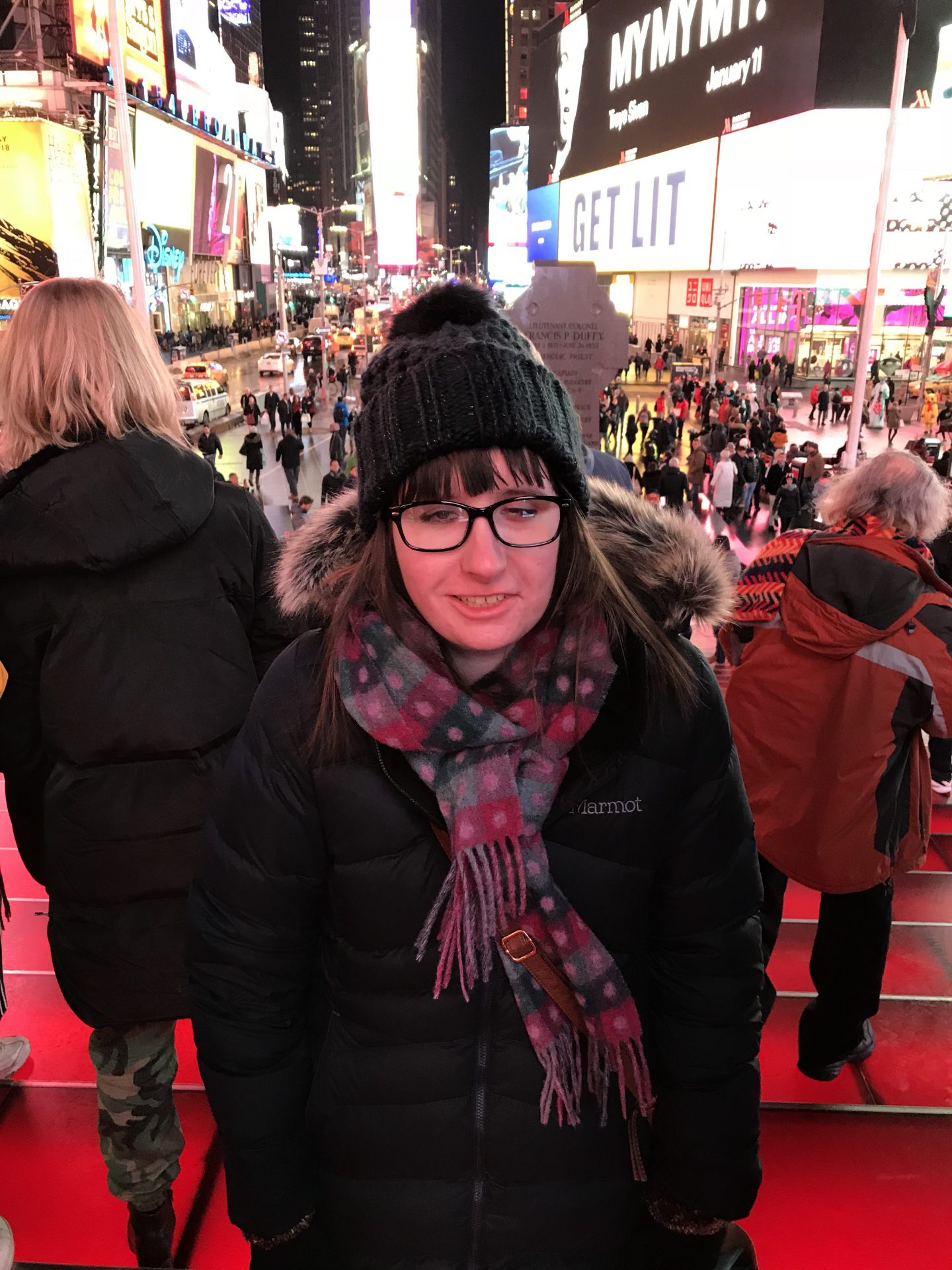 A photo of Holly at Times Square in the evening
