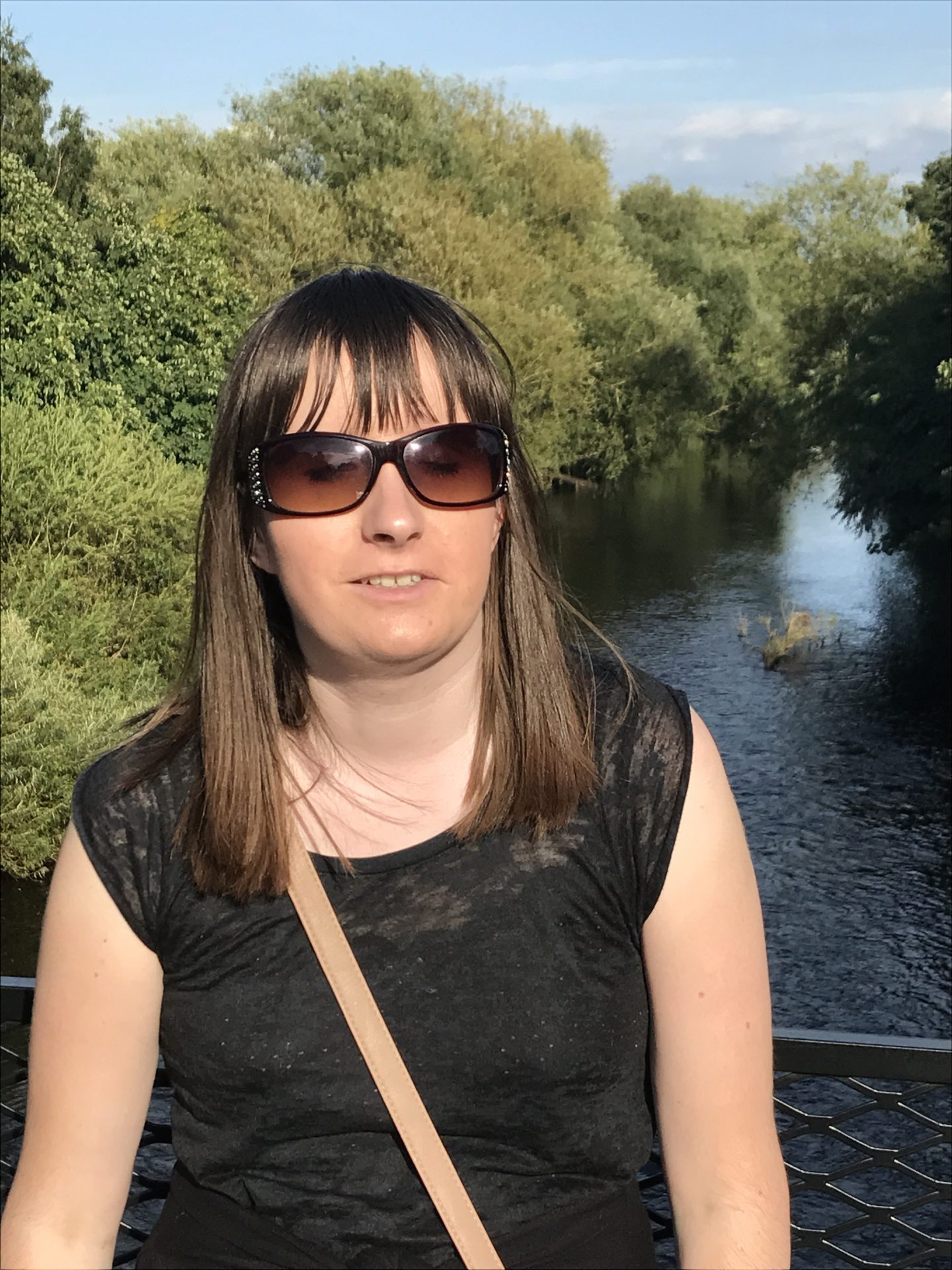 A photo of Holly wearing sunglasses