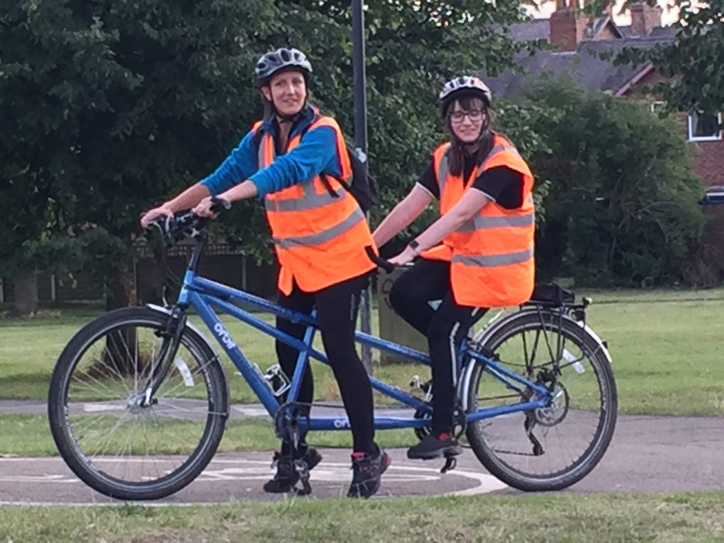 Holly and her friend on a tandem